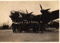 Fred couldn't tell us much about this photograph, but it is a Lancaster from the 101 Squadron. The letters SR are clearly visible on the fuselage. It appears to have a cartoon of 'Pluto' painted below the cockpit but no other visible markings.