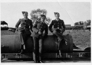Two similar photographs taken by Fred of his workmates. Isn't that a 4000lb bomb that they are sitting on?
