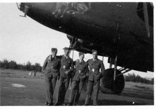 Four of Fred's wartime RAF workmates photographed beneath an unknown Lancaster.