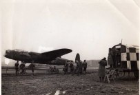 Nothing is known about this photograph but the 'P' can clearly be seen on the Lancaster. All its props are turning and the aircrew can clearly be seen within the canopy. The ground crew are staring at the cockpit as if it is about to leave on a mission. It's possible the aircraft could be Lancaster 'P' DV 389.